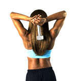 Tricep Press Silver. Woman doing a tricep press with a silver dumbbell stock image