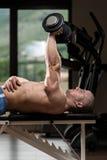 Triceps die met Domoor uitoefenen Stock Foto's