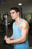 Triceps exercise at gym Stock Photos