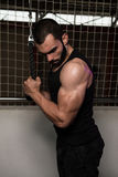 Triceps Pulldown Workout. Young Muscular Fitness Bodybuilder Doing Heavy Weight Exercise For Triceps In The Gym Royalty Free Stock Photography