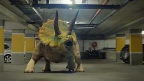 Triceratops horridus dinosaur in parking garage from the Jurassic era surreal 3d render stock illustration
