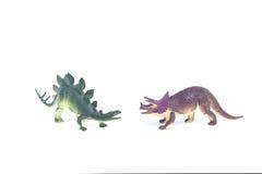 Triceratops and Stegosaurus dinosaur toy. On white background Royalty Free Stock Photo