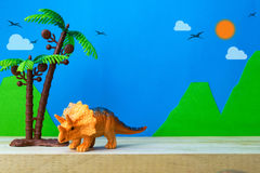 Triceratops toy model on wild models background. Closeup Royalty Free Stock Images