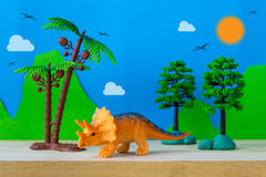 Triceratops toy model on wild models background. Triceratops dinosaur toy model on wild models background, closeup Royalty Free Stock Images
