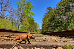 Triceratops walking on old rail road tracks. Triceratops walking on old rail road  tracks Royalty Free Stock Photo
