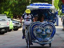 Tricicli al centro storico di Melaka, Malesia fotografia stock