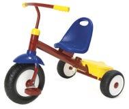 Triciclo Colourful su una priorità bassa bianca. Fotografie Stock