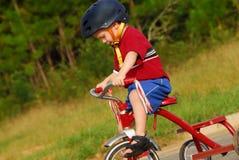 Triciclo del montar a caballo del niño Fotografía de archivo libre de regalías
