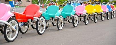 Triciclo no campo de jogos Fotografia de Stock Royalty Free