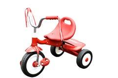 Triciclo rojo Imagenes de archivo