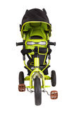 Triciclo verde aislado Imagenes de archivo