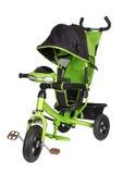 Triciclo verde aislado Foto de archivo libre de regalías