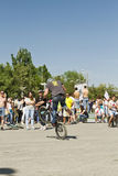 Trick on a BMX bike with the rotation of the rear wheel Royalty Free Stock Photos