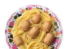 Trick from Chef. Spaghetti Stuck in Sausages. Spaghetti stuck in sausages in a dish Royalty Free Stock Photos