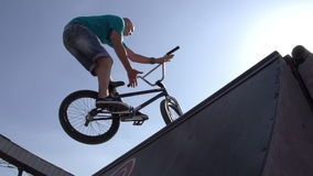 Trick Cycling. Competition among professionals and fans of extreme sports. Young men perform stunts on bikes. Slow Motion at a rate of 240 fps stock footage