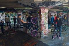 Trick cyclist at London Skate Park Stock Photos