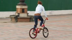 Trick cyclist. UKRAINE, KIEV, MARCH 24, 2010: Trick cyclist. Girl on bicycle in Kiev, Ukraine, March 24, 2010 stock video