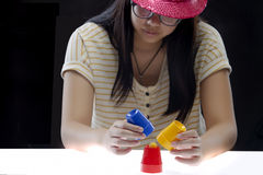 Trick with three cups. Performing trick with three cups by the girl royalty free stock photography