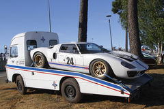 A trick transports a Ford GT 40 to Le Mans Stock Image
