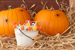 Trick Or Treat. At Halloween with pumpkins and candies Stock Photos