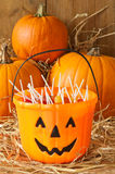 Trick Or Treat. Halloween candies in the barn with orange pumpkins Stock Photos