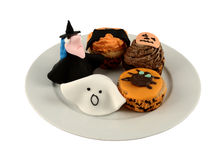 Trick or Treat. A plate of home made halloween iced cakes and marzipan fancies stock images
