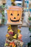 Trick or Treat. Row of pumpkin face buckets for candy Royalty Free Stock Photo
