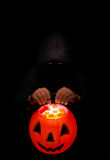 Trick or Treat. Spooky Goblin with Glowing Trick or Treat Pumpkin Royalty Free Stock Photo