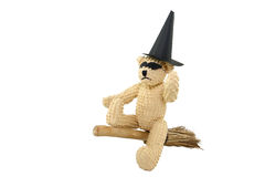 Trick-Or-Treat Bear. A small teddy bear all ready for some Halloween fun! This bear wears a black mask and paper witches hat while sitting on a small broom Royalty Free Stock Photo