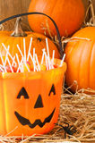 Trick Or Treat Candies. Trick or treat Halloween candies in the barn with orange pumpkins Royalty Free Stock Photo