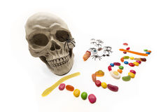 Trick or Treat candy and bugs with skull on white Stock Photos