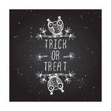 Trick or treat on chalkboard background Stock Photo