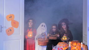 Trick-Or-Treat. Children sing a trick-or-treat song and a woman gives them sweets stock footage