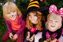 Trick-or-treat girls. Three trick-or-treat girls looking at camera Stock Image