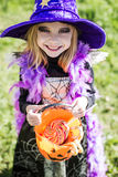 Trick or treat. Halloween character: beautiful little witch Royalty Free Stock Photography