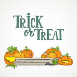 Trick or treat - Halloween party hand drawn lettering and sketch with cute pumpkins on the porch. Fun colorful greeting Royalty Free Stock Photography