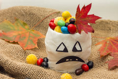Trick-or-treat. Image of mummy-cup with candies Stock Photos