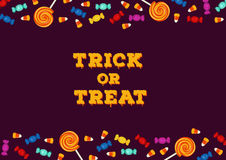 Trick or treat inscription with horizontal border made of candies. Happy Halloween holiday concept greeting card Royalty Free Stock Photo