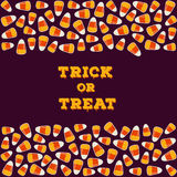 Trick or treat inscription with horizontal border made of small candy corns. Halloween holiday concept greeting card Royalty Free Stock Image