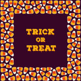 Trick or treat inscription with square frame made of candy corns. Halloween holiday concept greeting card, poster. Stock Image