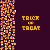 Trick or treat inscription with vertical border made of small candy corns. Halloween holiday concept greeting card. Trick or treat inscription with vertical Royalty Free Stock Images