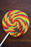 Trick or treat lollipop candy with spider. Royalty Free Stock Image