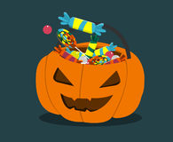 Trick or treat pumpkin. Halloween pumpkin with sweets for trick or treating kids Royalty Free Stock Photography