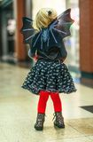 Modern child in bat costume on Halloween at mall Royalty Free Stock Photos