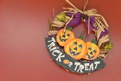 Trick Or Treat Sign on Door. Halloween seasonal holiday background concept Stock Photos