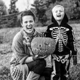 Mother and child showing Halloween pumpkin Jack O'Lantern Stock Photos