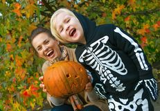 Mother and child showing carved Halloween pumpkin Royalty Free Stock Photography