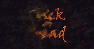 Trick or Treat text dissolving into dust to left stock footage