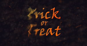 Trick or Treat text dissolving into dust to left Royalty Free Stock Images
