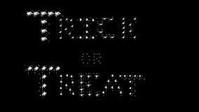 Trick or Treat, white, black. Halloween message of Trick or Treat in white sparkling letters on black stock video